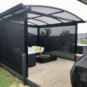 Black Freestanding Pergola Awning creating outdoor shade