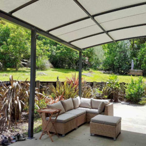 Outdoor seating area under pergola awning