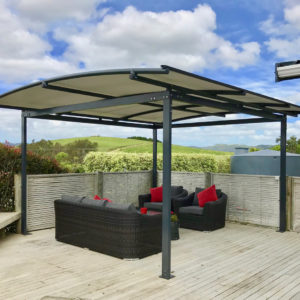 Freestanding Pergola covering seating area on deck