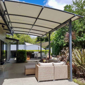 Shaded patio under Pergola System W96 fabric